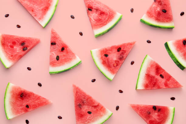 watermelon slices pattern viewed from above. top view. summer concept. - fruit imagens e fotografias de stock