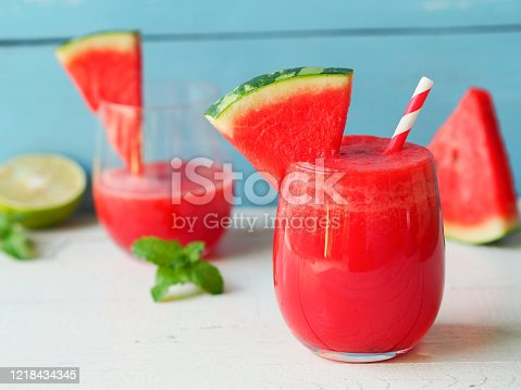 Watermelon smoothies topping with fresh watermelon for summer drinks concept.