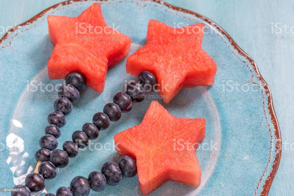 Watermelon stars with blueberry stick stock photo