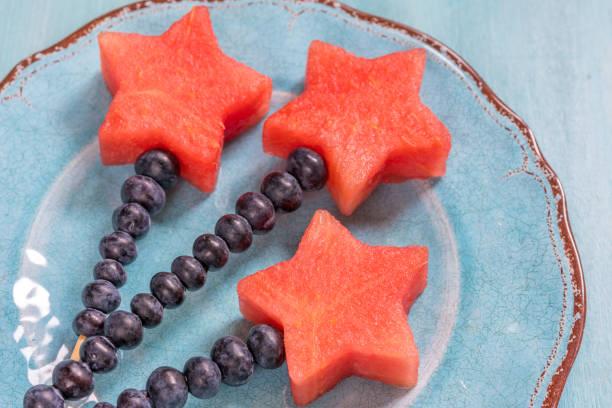 Watermelon stars with blueberry stick stock photo