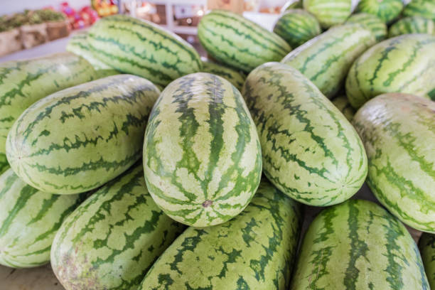 Watermelons for sale A pile of watermelons for sale at a farmer's market in Cooley Springs, upstate South Carolina. apostate stock pictures, royalty-free photos & images