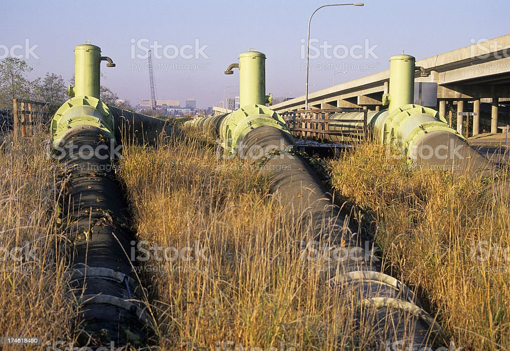 Waterpipes and freeway royalty-free stock photo