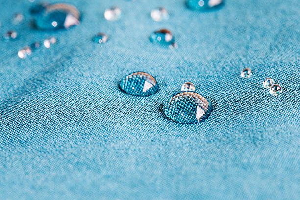 Waterprof fabric waterprof fabric with waterdrops waterproof clothing stock pictures, royalty-free photos & images