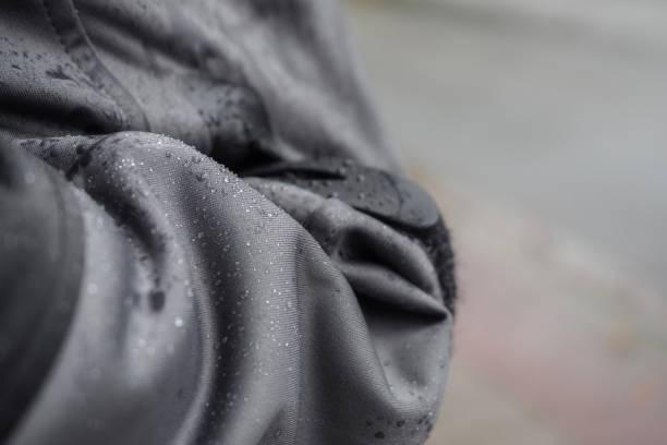 Waterproof jacket with rain drops stock photo