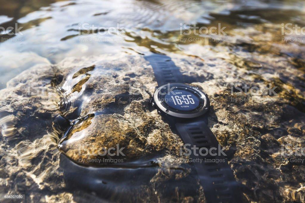 Waterproof sport watches underwater. Fitness tracker for swimming stock photo