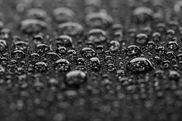 Waterproof textile after rain - covered with water drops