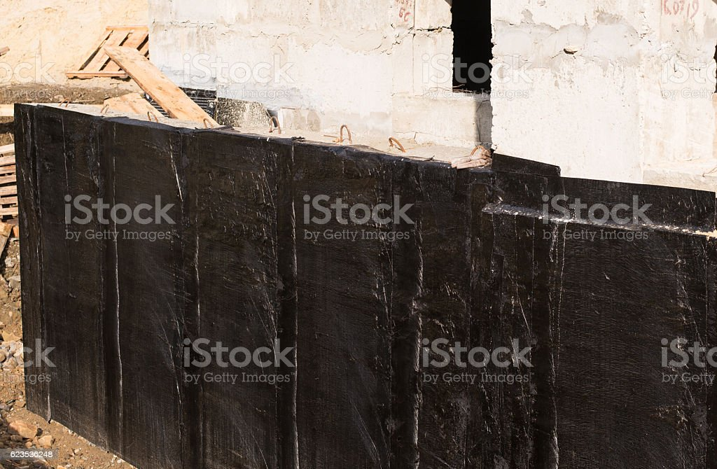 Waterproofing basement and foundations stock photo
