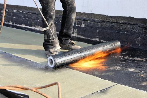 Waterproofing Flat Roof With Bitumen Sealing Membranes Stock Photo - Download Image Now - iStock