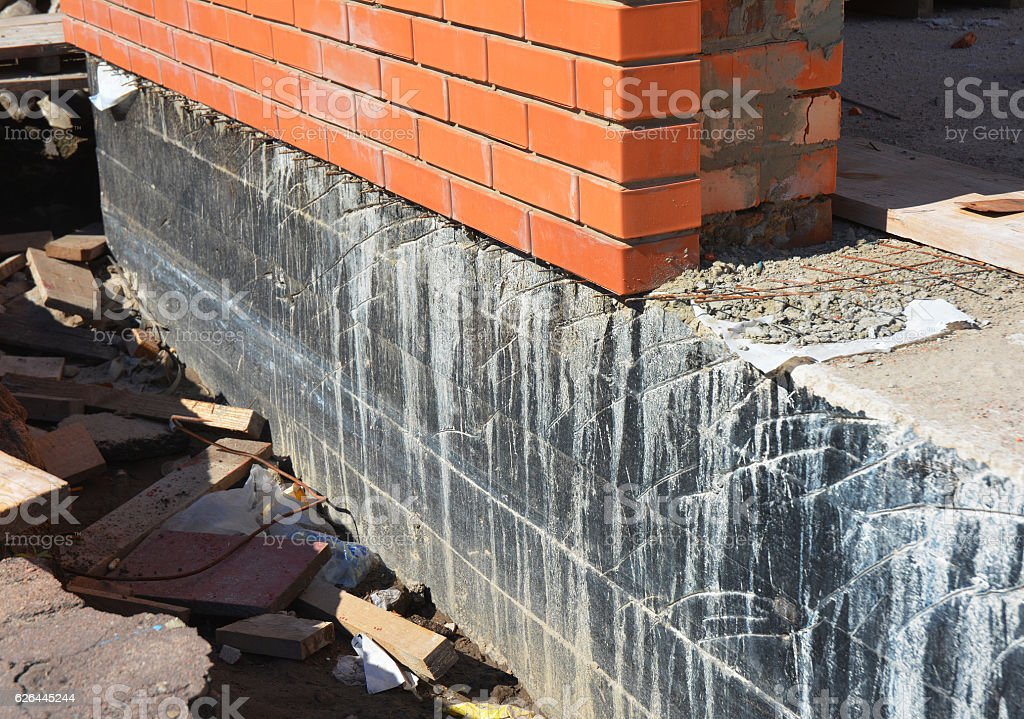 Waterproofing foundation walls. Foundation Waterproofing and Damp proofing Coatings stock photo