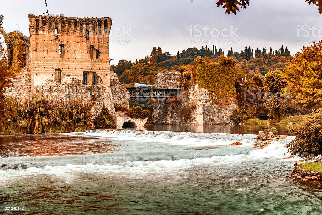 Waters and ancient buildings of Italian medieval village stock photo