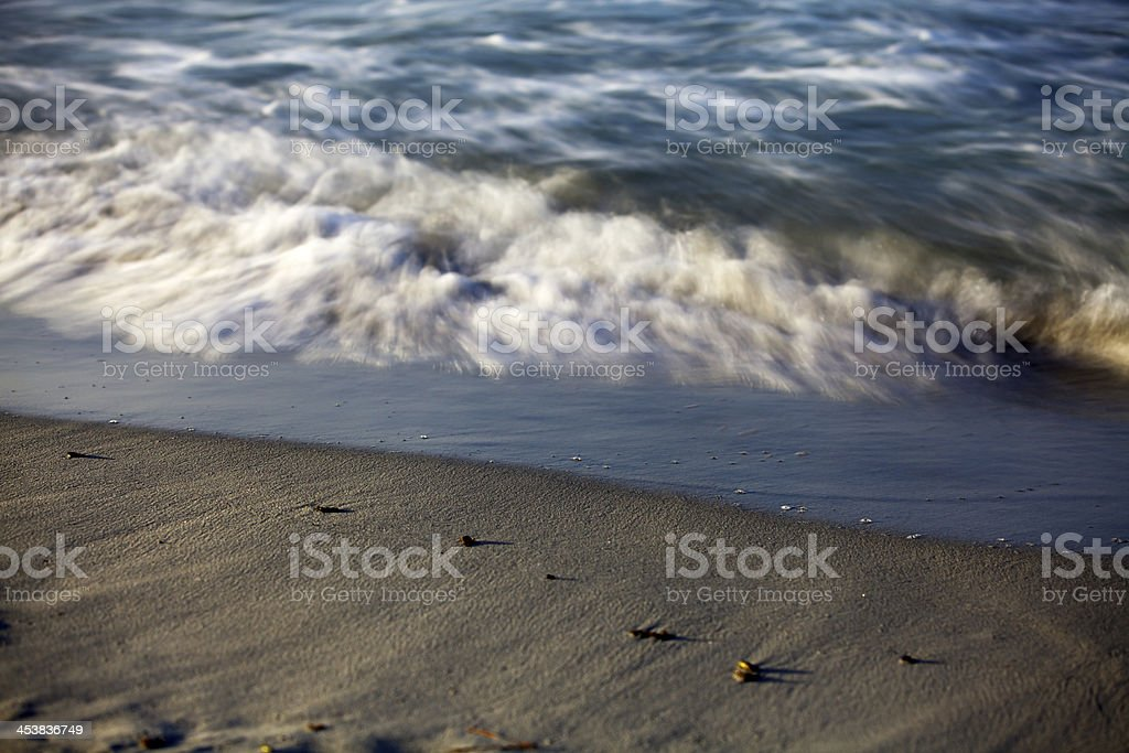 Water's edge, wave motion blur. royalty-free stock photo
