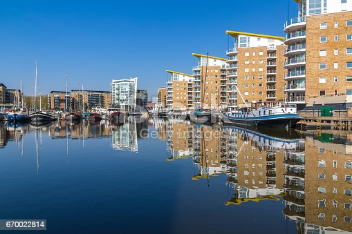 Waterside apartments at Limehouse Basin Marina with Docklands Light Railway passing in the background