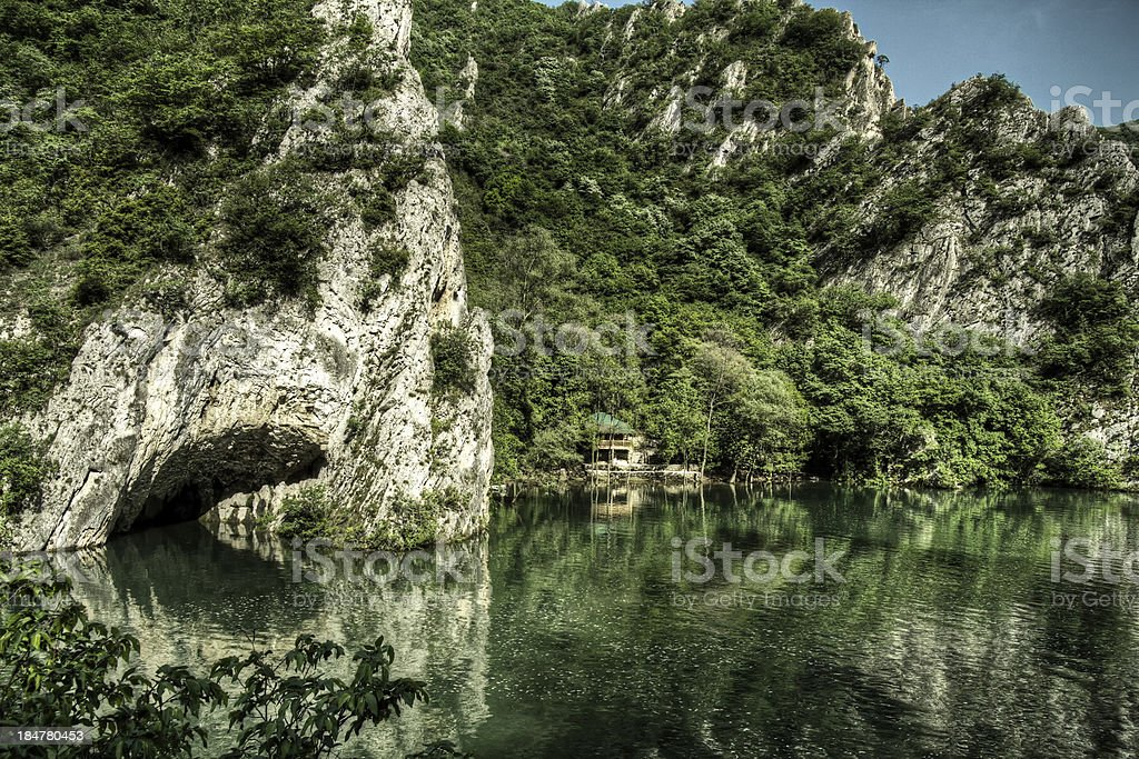 Waterside Cave with House royalty-free stock photo