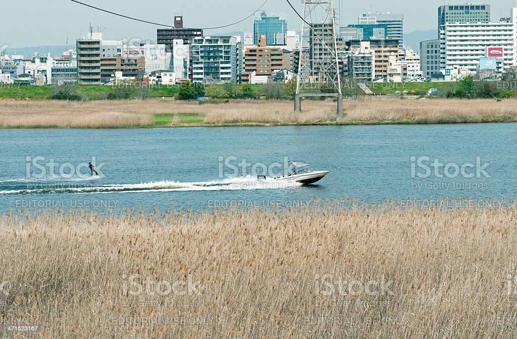 Waterskier on Yodo River in Osaka royalty-free stock photo