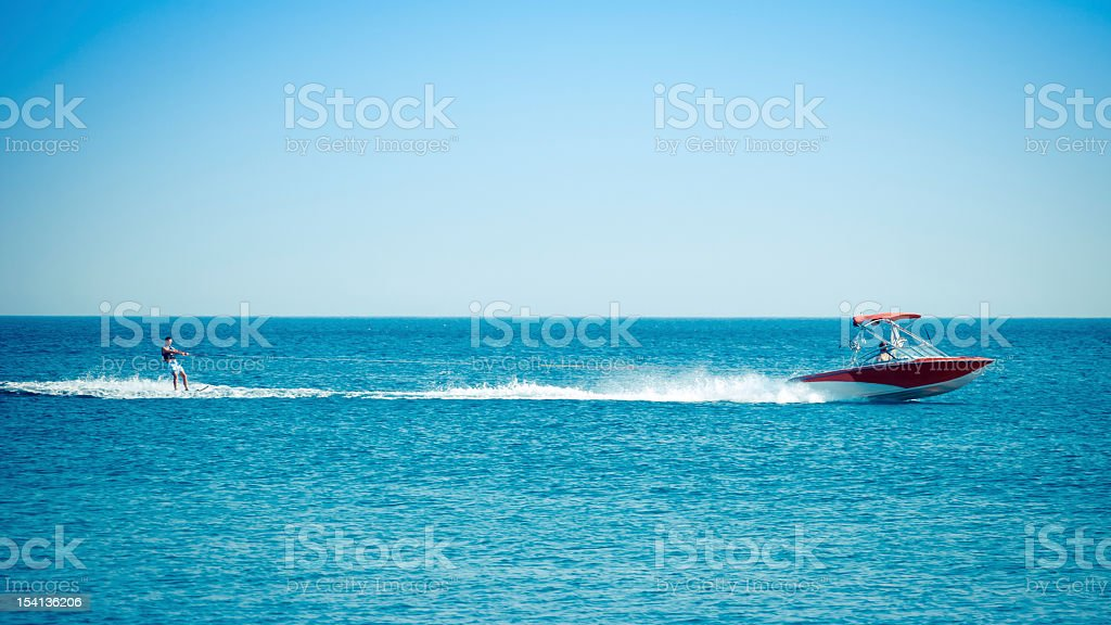 Waterskiing at sea stock photo