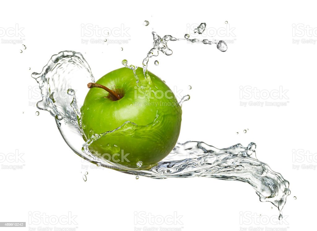 Water-splashed Granny Smith apple stock photo