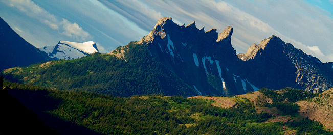 Clouds align with mountain angles in Waterton National Park, Alberta