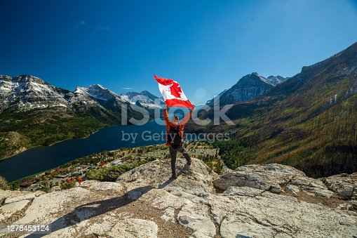 istock Waterton Lakes National Park and man with Canada flag 1278453124