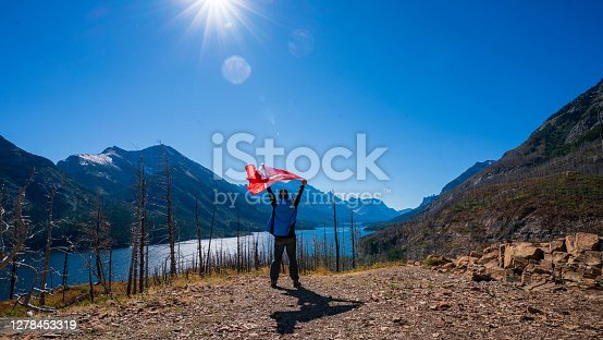 istock Waterton Lakes National Park and man with Canada flag 1278453319