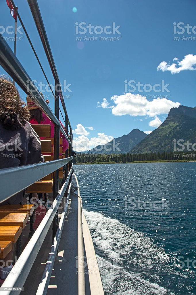 Waterton National Park tourboat  with view from Waterton Lake stock photo