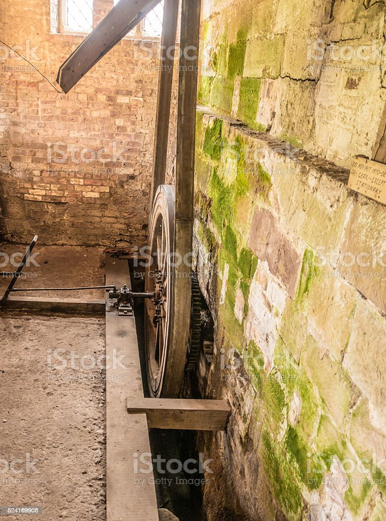 Waterwheel machienery at the old water mill. stock photo