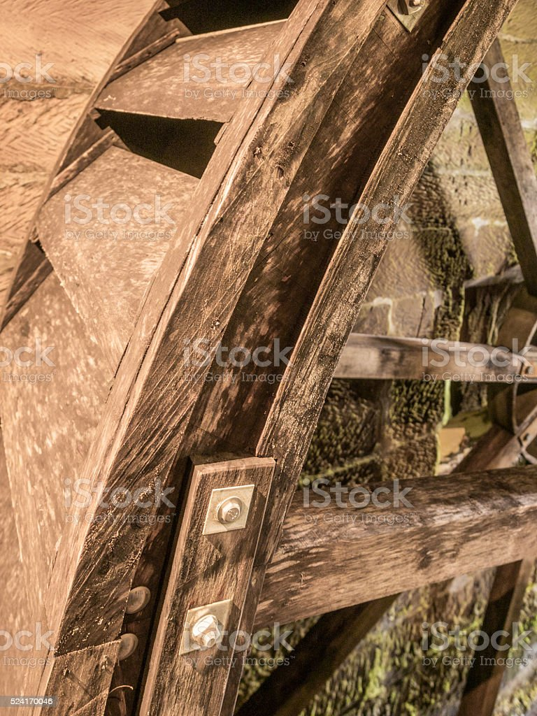. Waterwheel machienery at the old water mill. stock photo