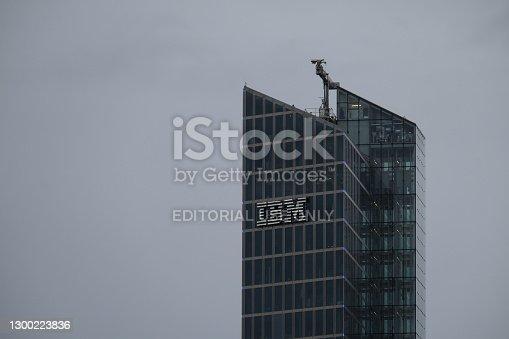 Munich, Bavaria Germany - February 3 2021: IBM International Business Machines Corporation logo german headquarters tower. Watson IoT Center artificial intelligence research and development building.