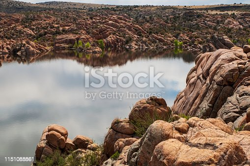 Watson Lake in Prescott, Arizona, USA on a sunny spring day with the clouds reflecting upon the water