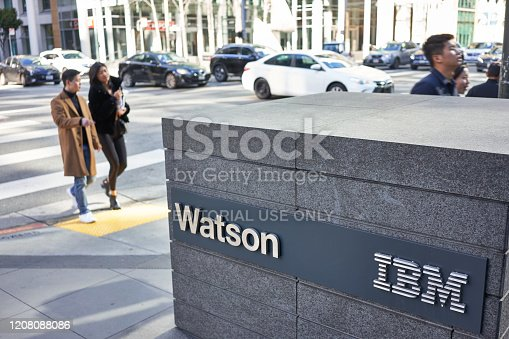 San Francisco, CA, USA - Feb 8, 2020: People walking past the IBM Watson sign outside its San Francisco office. Watson is a question-answering computer system capable of answering questions posed in natural language.