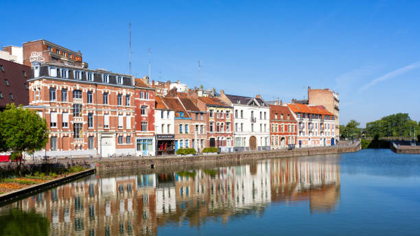 Wault quay in Lille, France. Lille, France - May 2018. Old houses located at the Wault quay near the citadel of Lille. Shot against a clear blue sky. hauts de france stock pictures, royalty-free photos & images