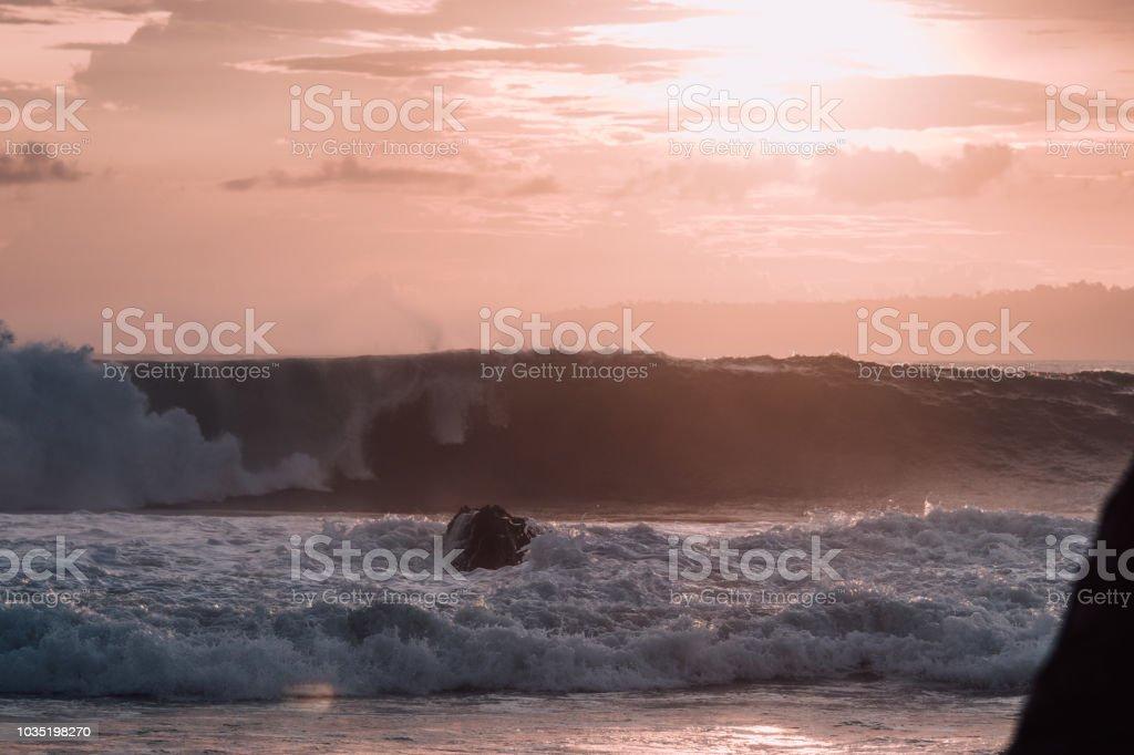 Wave breaking in evening glow