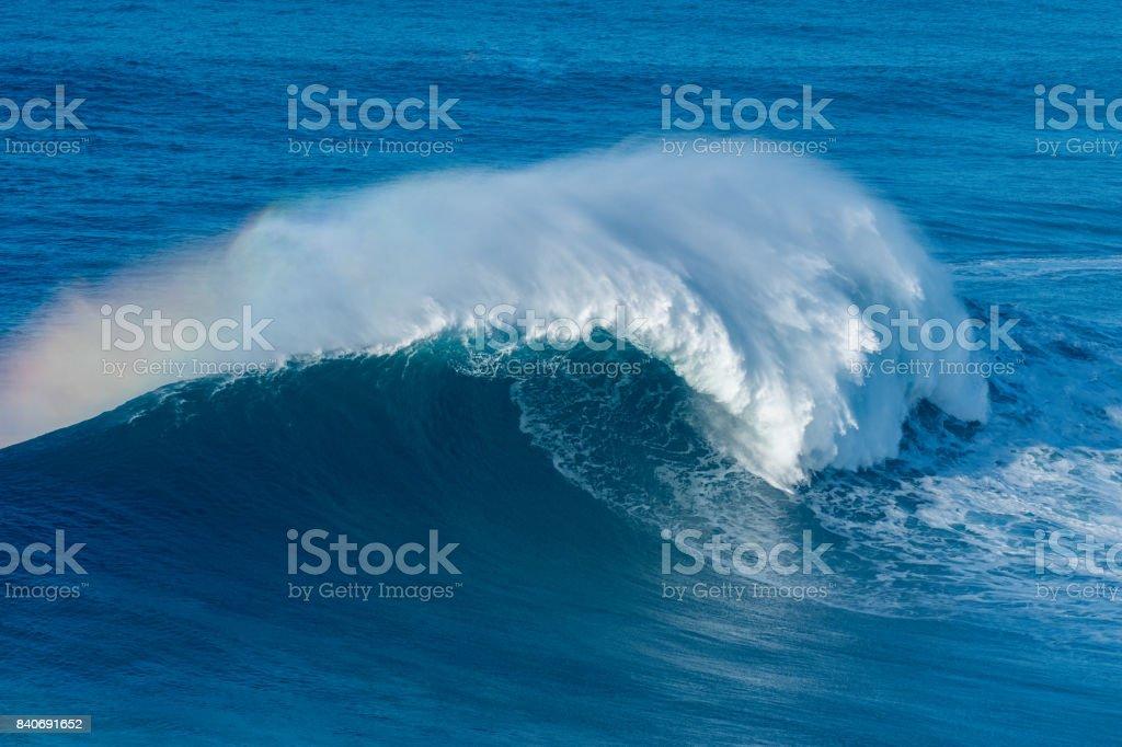Wave breaking in Nazare stock photo