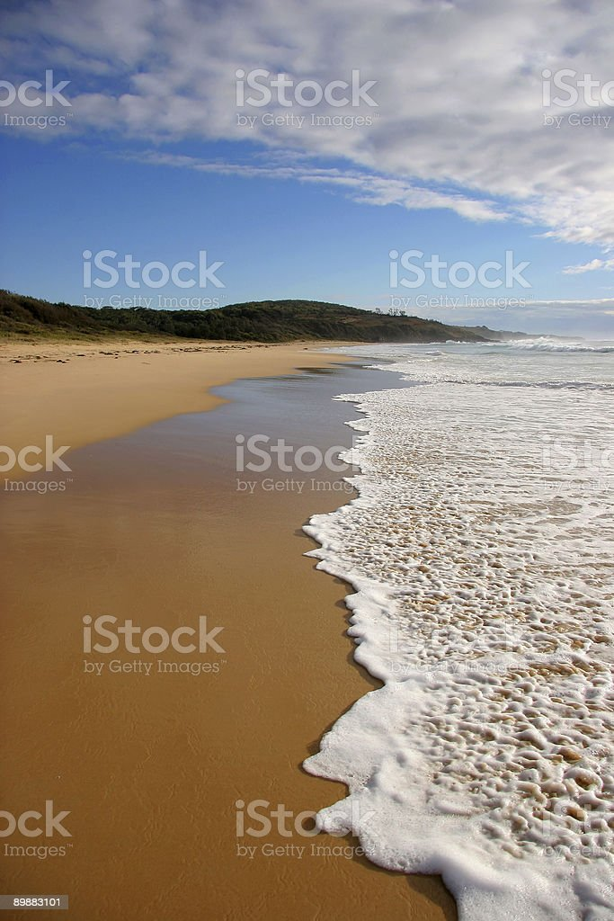 Wave breaking on a beach royalty-free stock photo