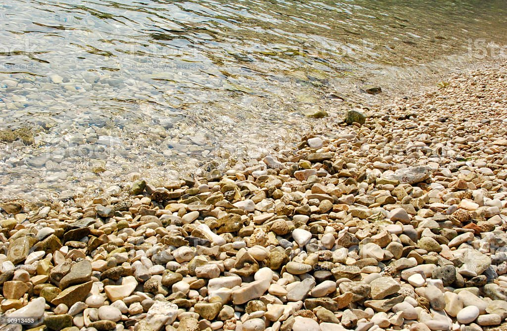 Wave breaking on the pebbles royalty-free stock photo