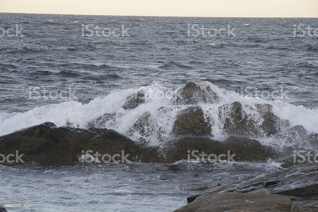 Wave Breaking over Rocks royalty-free stock photo