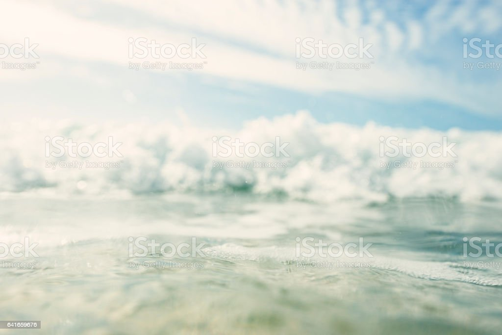 Wave Breaking towards Camera at Porthcurno Beach Cornwall stock photo