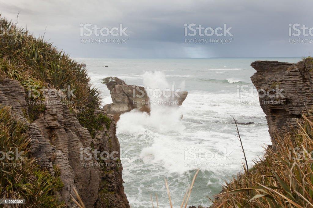 Wave crashing into the rocks, Pancake Rocks stock photo