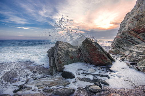 Wave crashing on rocks