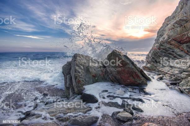 Photo of Wave crashing on rocks