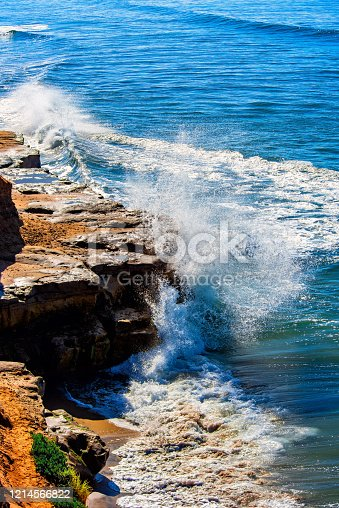 A wave crashing on the rocky cliffs of northern San Diego County; Carlsbad, California.