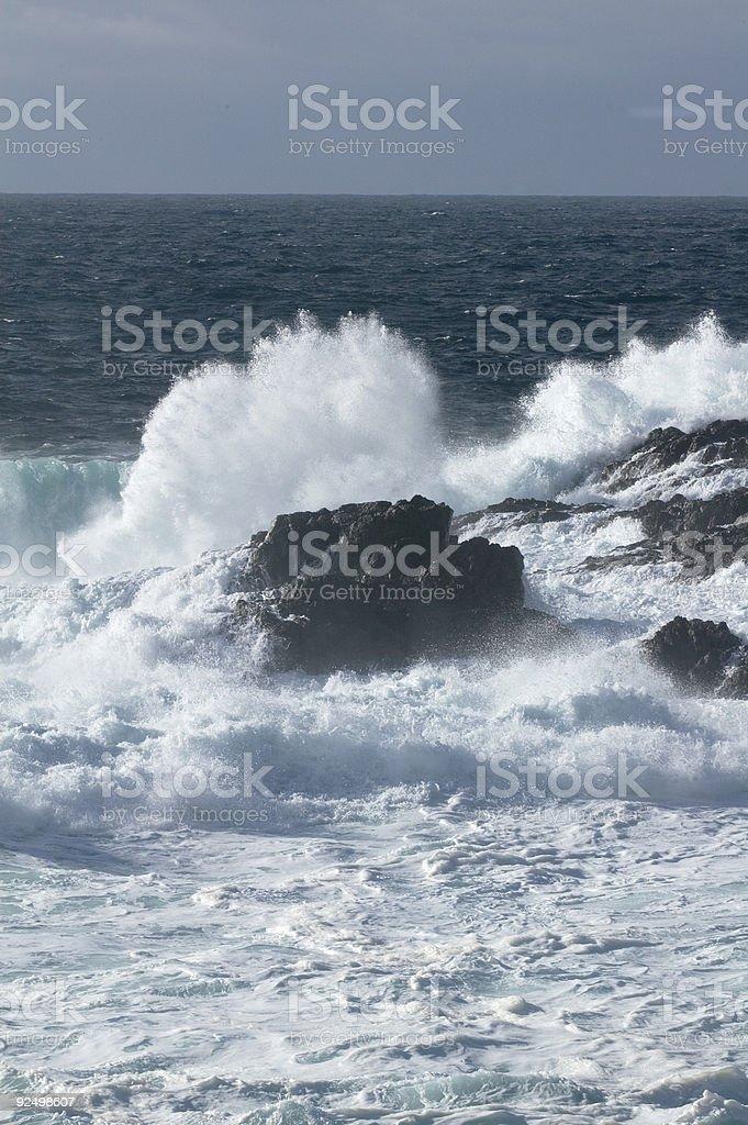 Wave crashing over rock royalty-free stock photo