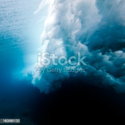 istock Wave crashing underwater 160585120