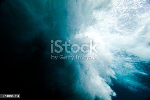 istock Wave crashing underwater 174984224