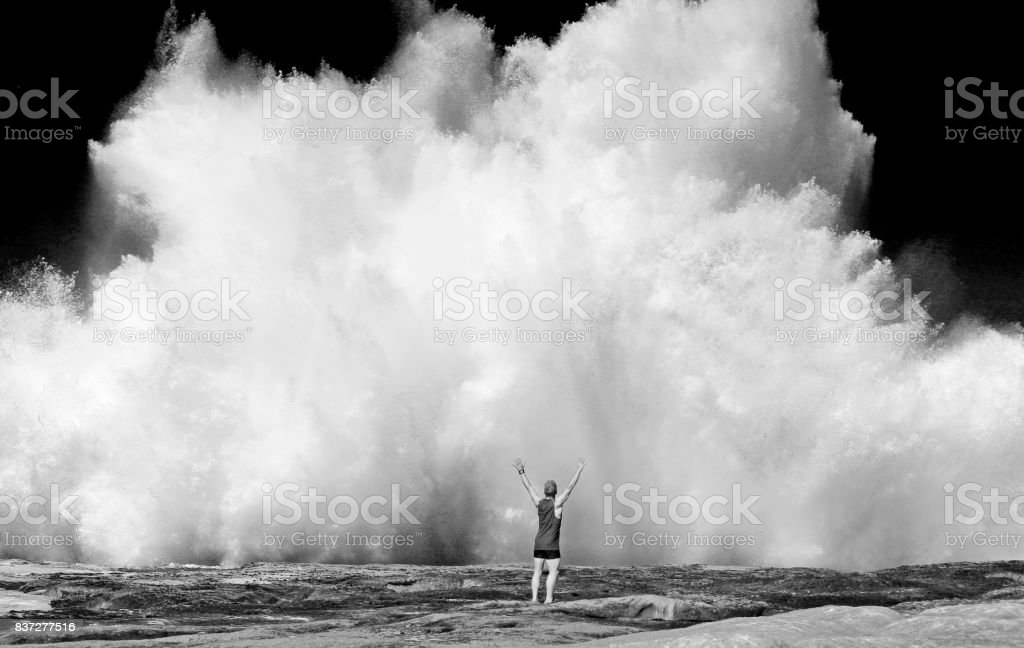 Wave crush man water sea ocean power forse shore black and white