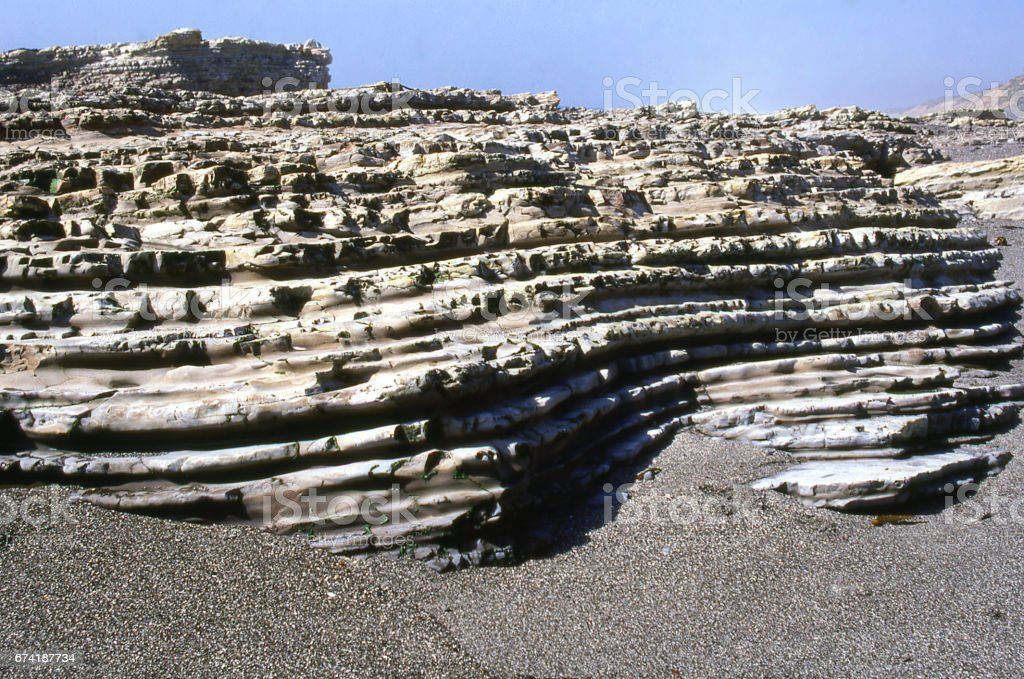 Wave cut platform and sedimentary rock outcrops along the shore in Montana de Oro State Park California stock photo