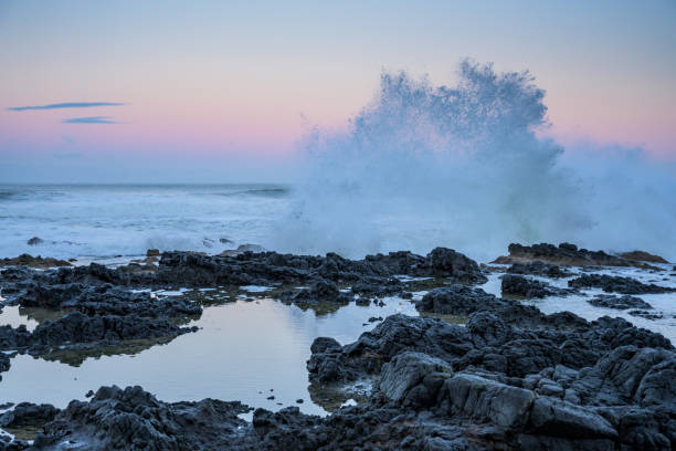 Wave Explodes Above Thors Well stock photo