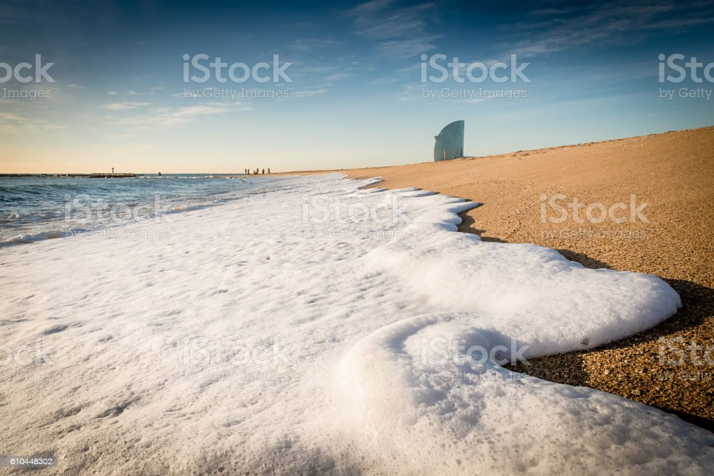 Wave foam on the beach stock photo