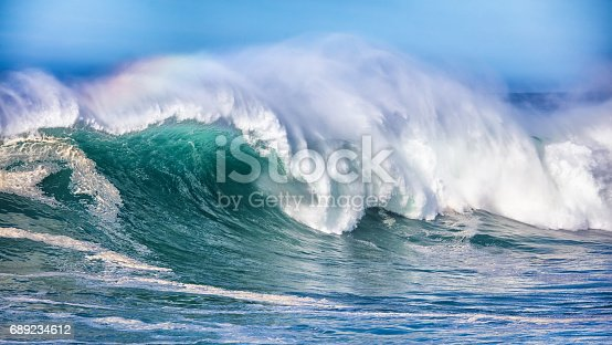 Wave in Pacific Ocean breaking in northern California