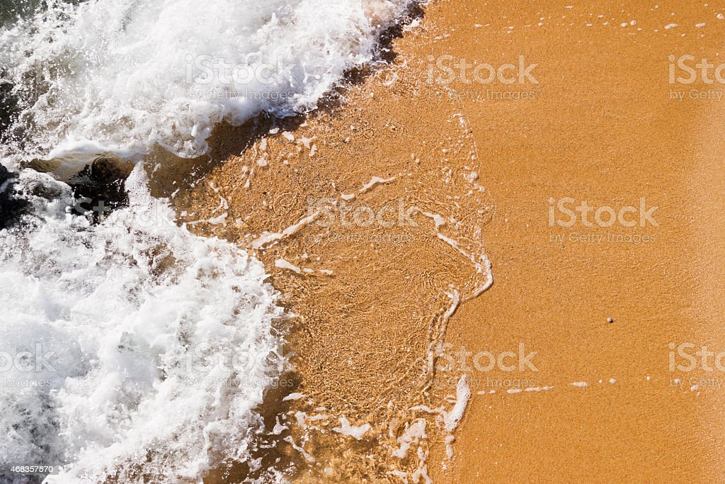 Wave in the sand of the beach background royalty-free stock photo