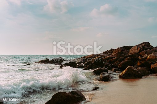 Wave Of Sea On Sand And Rock Beach Stock Photo & More Pictures of Beach